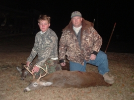 John and his dad, David, with his first deer.